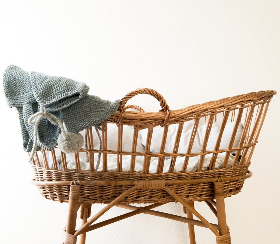 Baby basket with cashmere baby blanket.