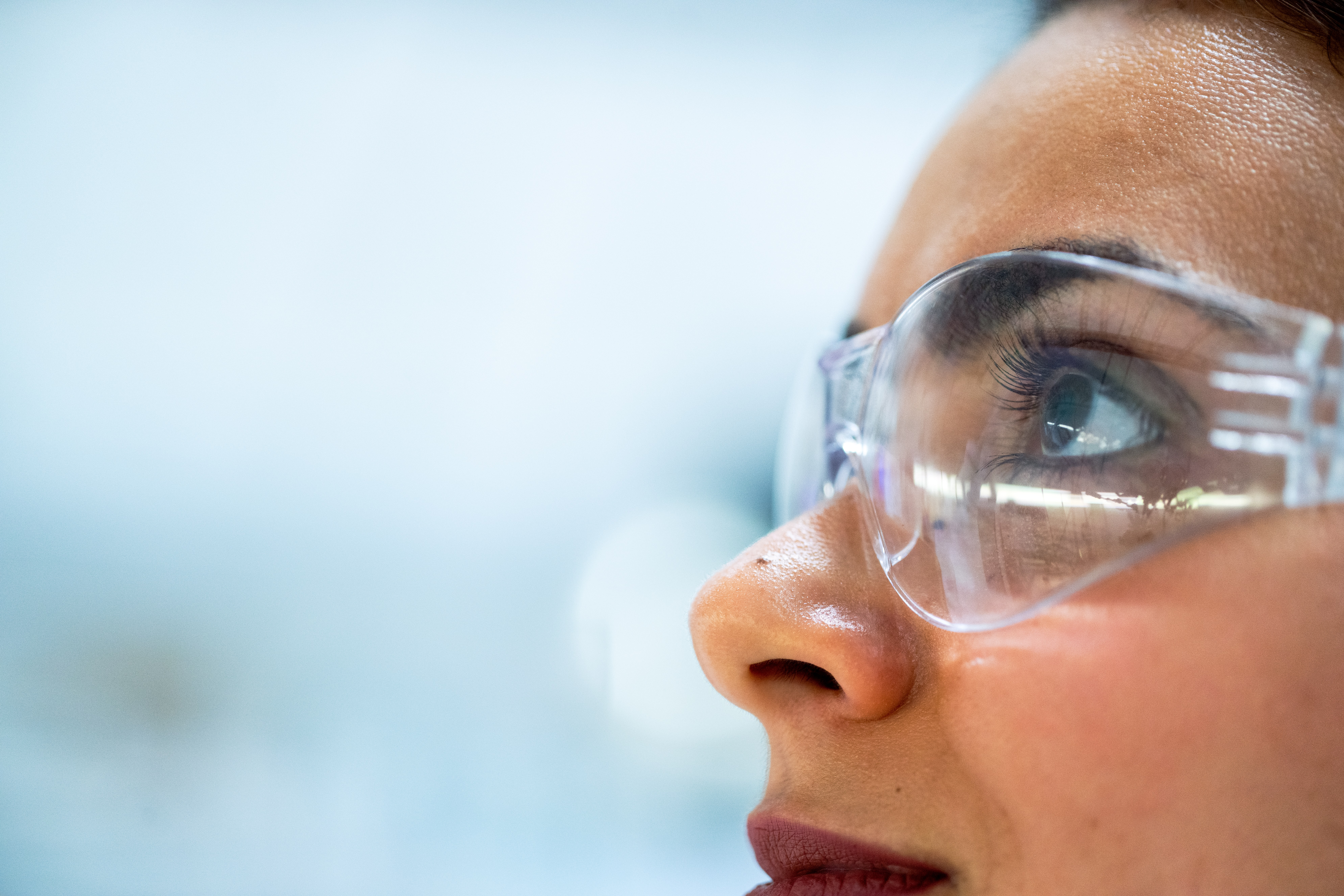 Scientist looking with lab goggles