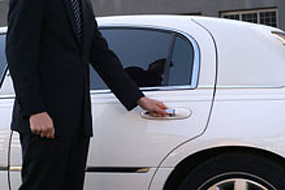 Person opening car door for patient