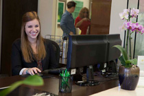 Front desk staff smiling