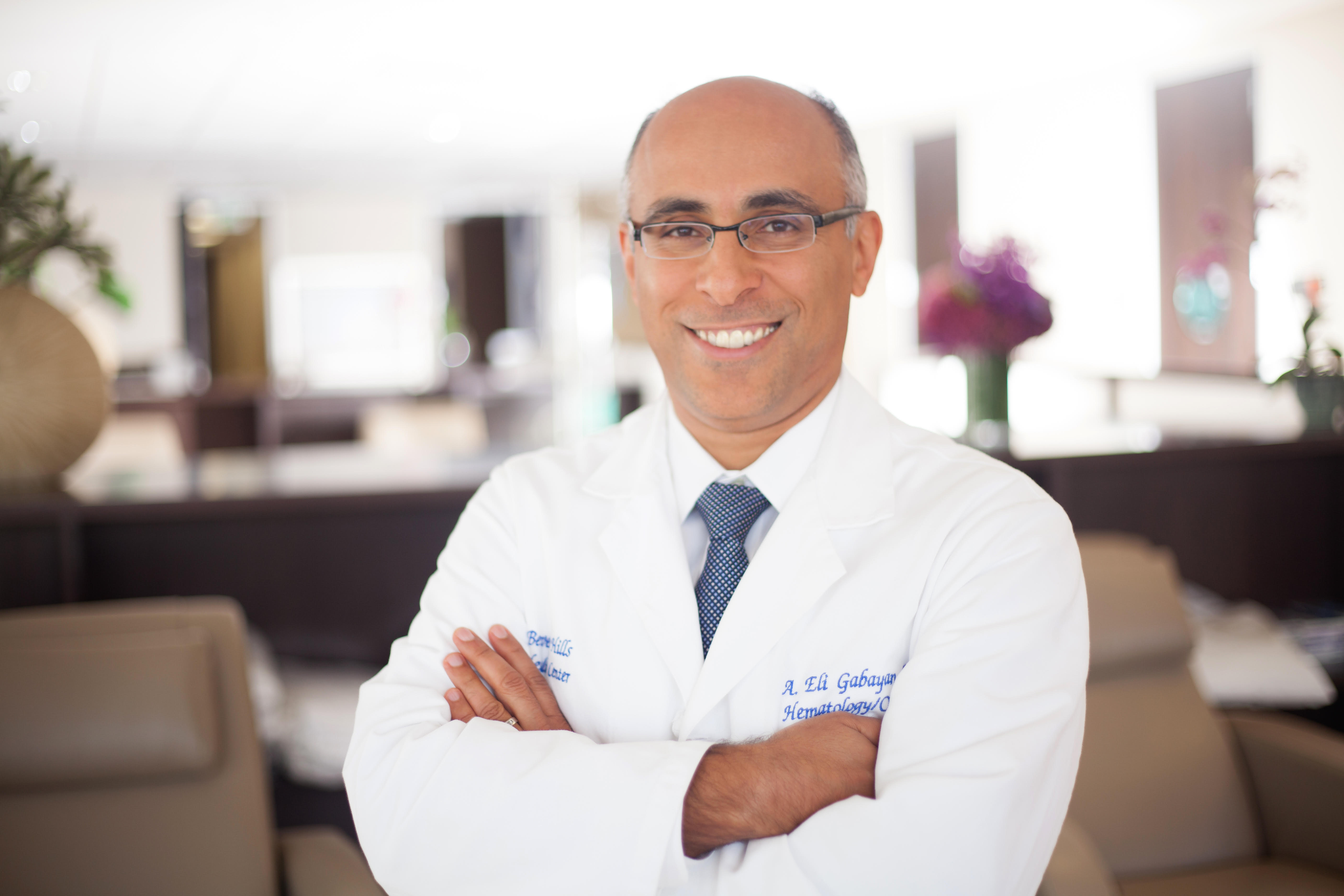 Doctor smiling and looking into the camera