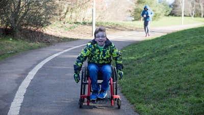 Young boy in wheelchair moving fast