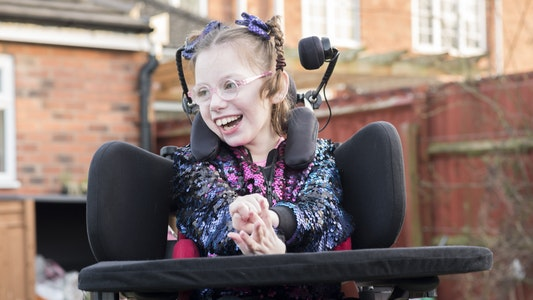 Smiling young girl in wheelchair