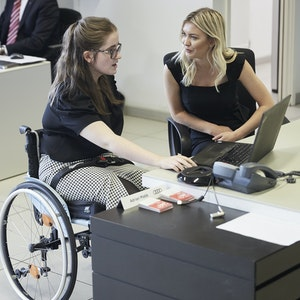 young lady  in wheelchair in work