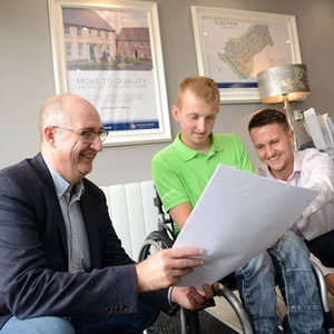 young male wheelchair user in business environment