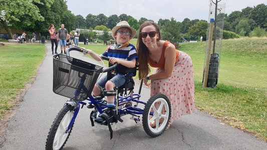 young man on adapted trike