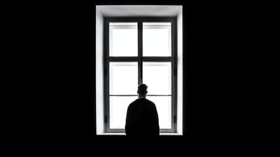 lonely man looks out window