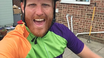 young man on bike fundraising