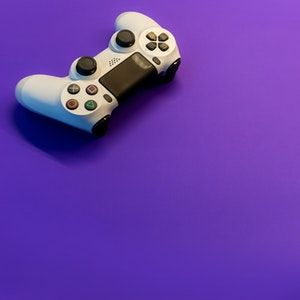 playstation control on purple background
