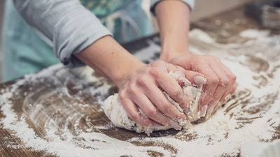 Woman baking with dough