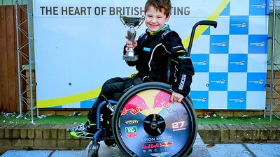 matt collecting a racing trophy