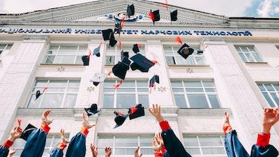 university hats being thrown