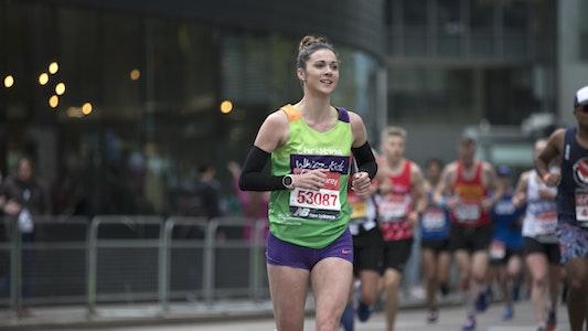 Tall lady in shorts running London Marathon