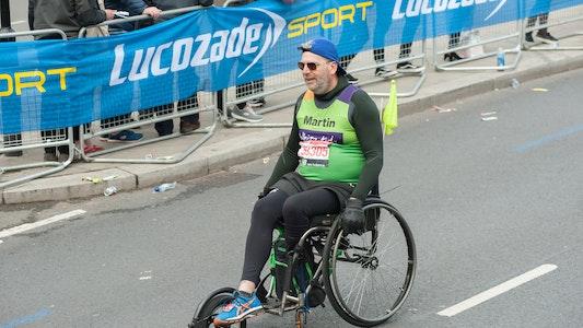 Man wheeling the London Marathon