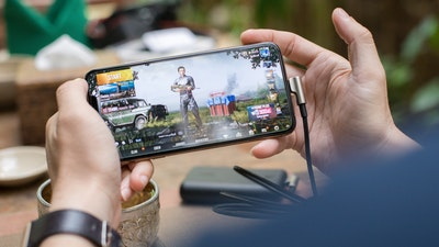 person on mobile game