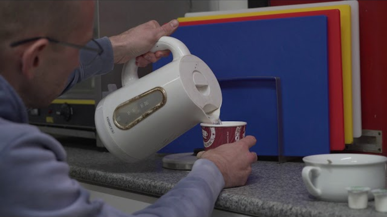 wheelchair user making hot drink