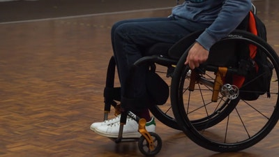 wheelchair skills training - moving backwards