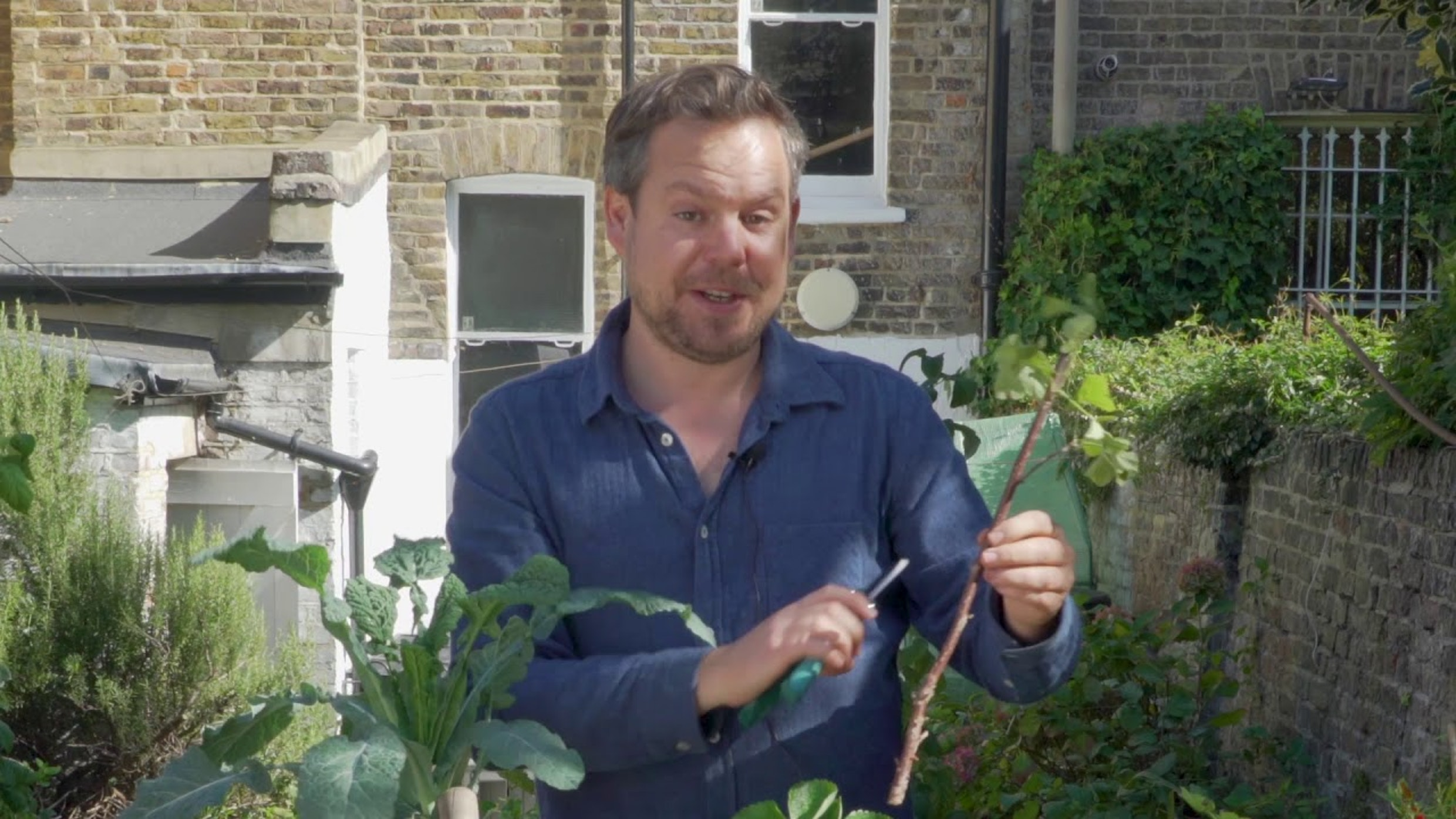 Phil from 'Green up your Act' holding plants