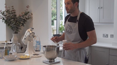 nick preparing scones in kitchen