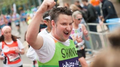 Whizz-Kidz runner Shane celebrating on the course