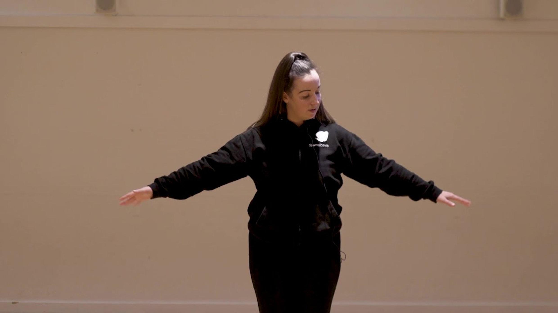 lauren guiding dance classes in black