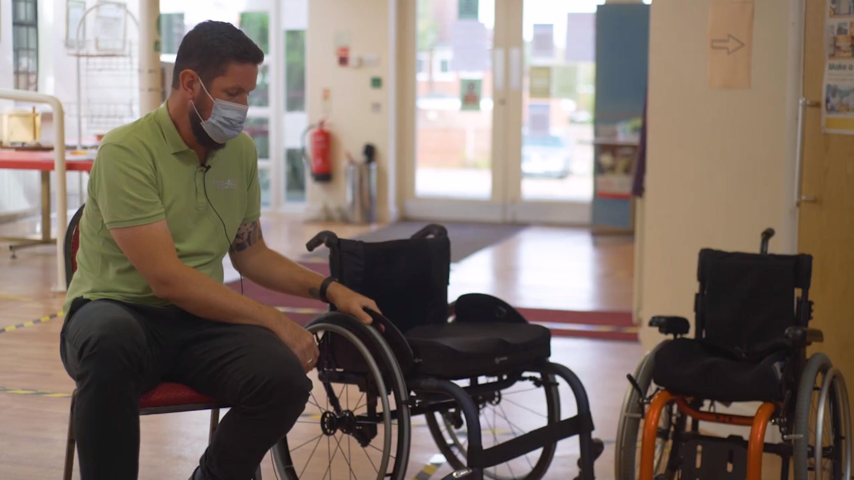 john explaining how manual wheelchair brakes work