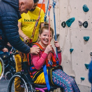 young girl on climbing wall