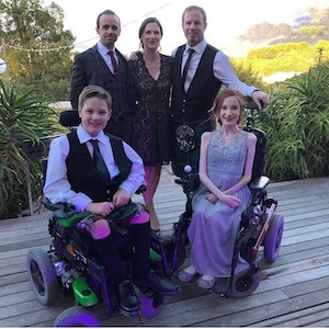 London Marathon runner benedict with his family which includes two young peoplw who are wheelchair users
