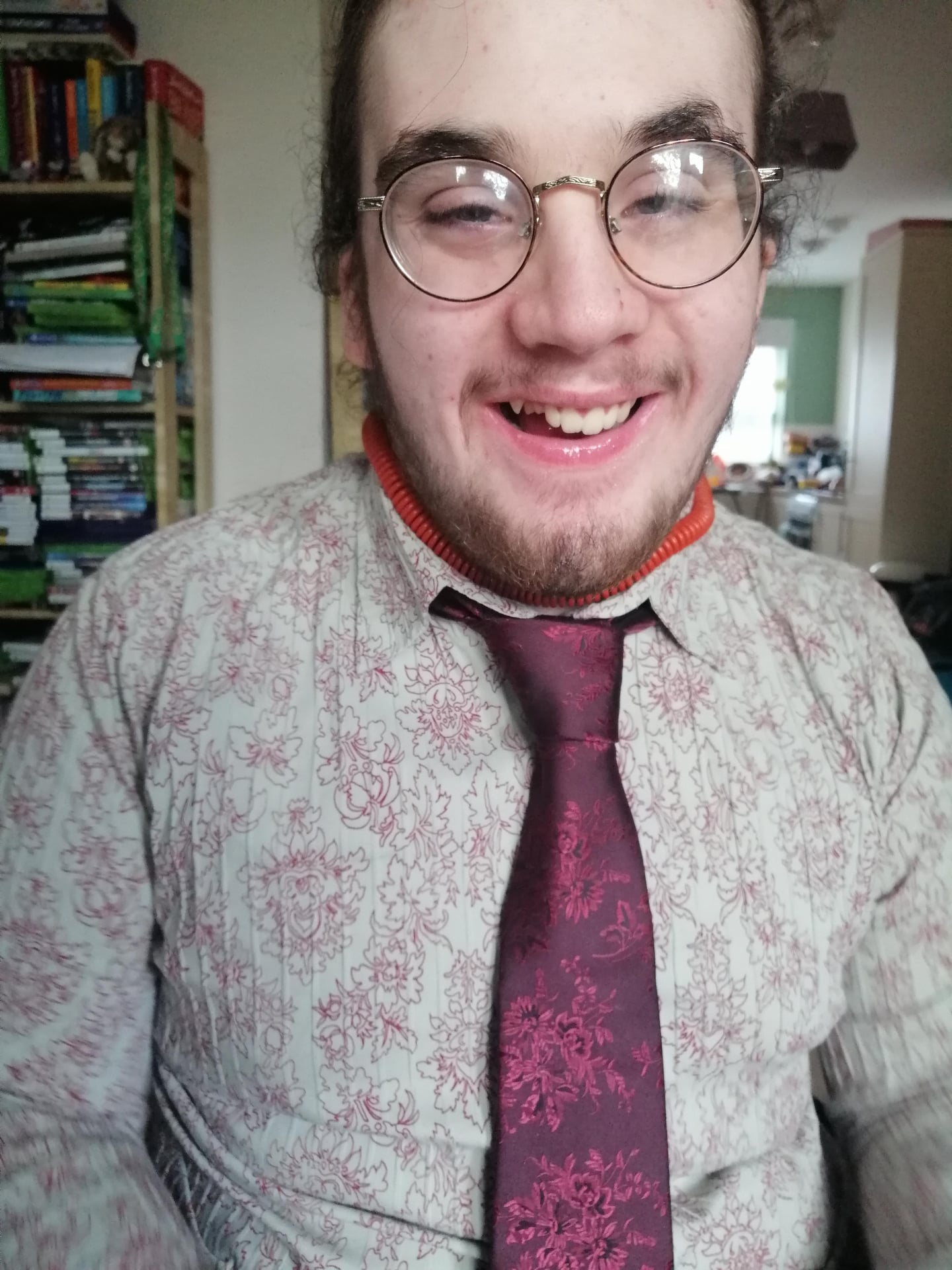 Owen wears a shirt and tie for his work placement