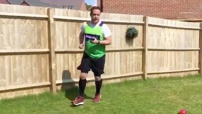 Man Running in a Whizz-Kidz vest in his garden