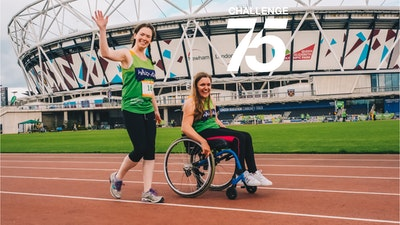 two smiling women infront of Olympic Stadium at challenge 75
