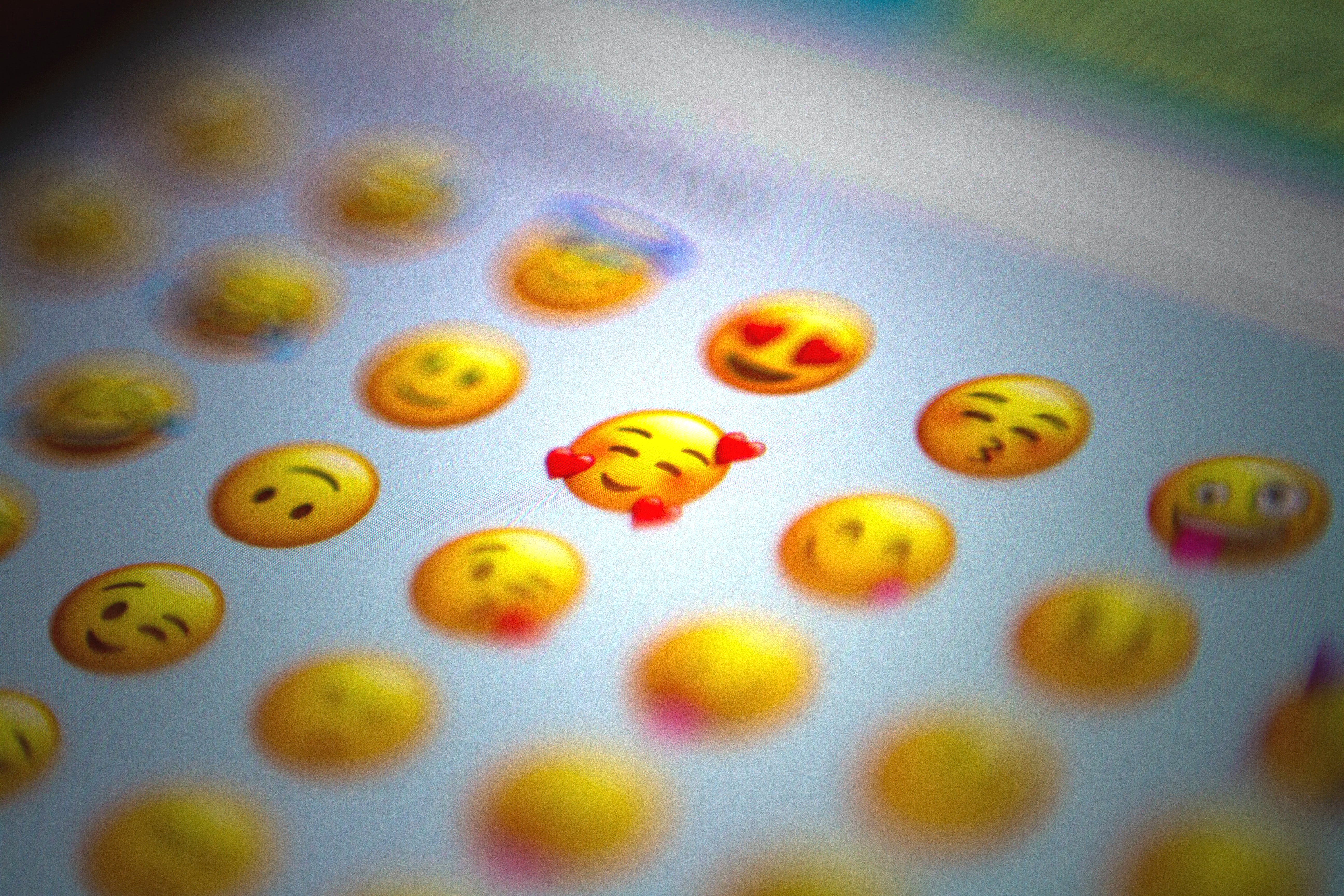 A collection of emojis on a mobile phone screen - Photo by Domingo Alvarez E on Unsplash