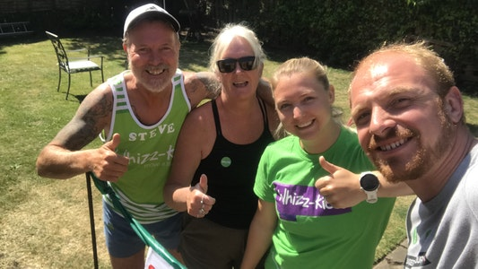 Shannon poses with friends at her garden finish line