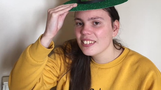 Charlotte poses with the leprechaun hat she made at a Whizz-Kidz virtual club