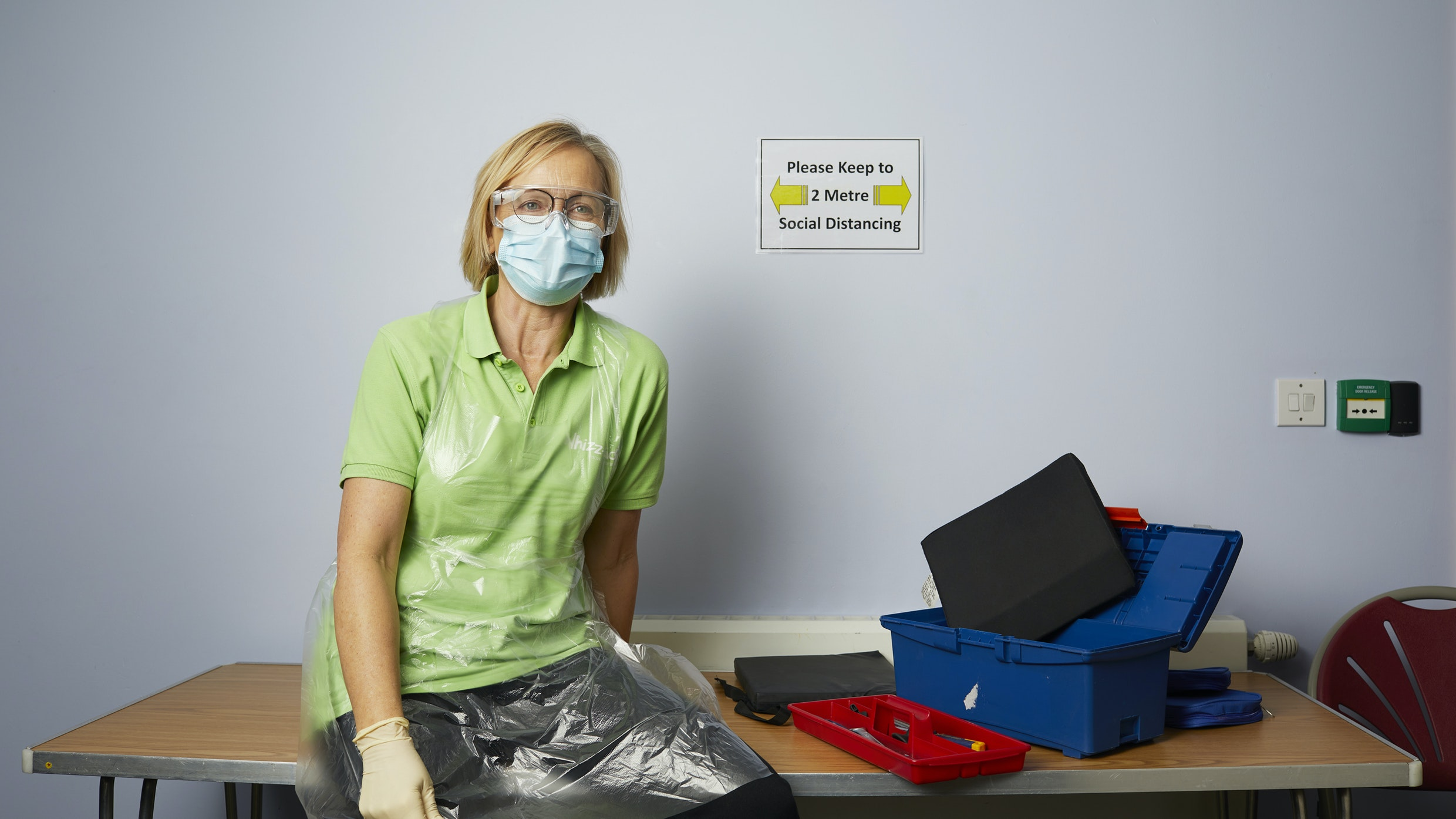 A Whizz-Kidz worker poses in PPE