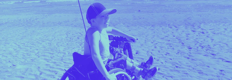Harrison at the beach in his Whizz-Kidz wheelchair