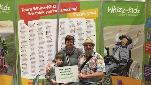 Wheelchair user and family at London Marathon Running Show
