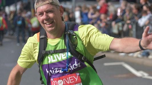 Man giving high five at London Marathon