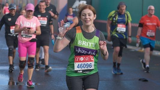 Woman waving at London Marathon