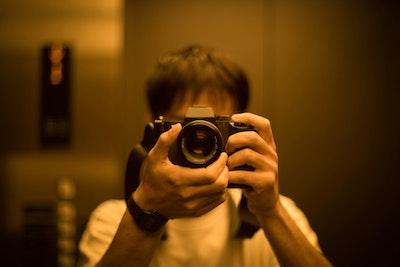 Tags: human, person, electronics, camera