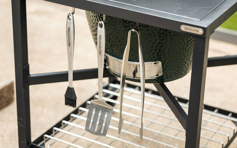 Large Big Green Egg in a Modular Nest Tool Hooks close up