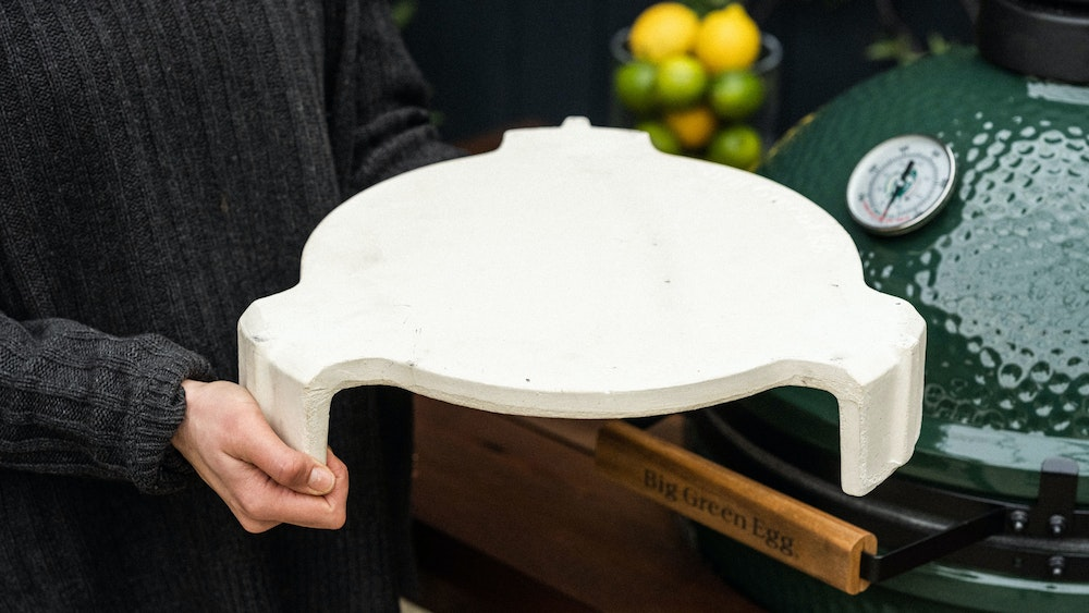 Simply slot it into your Big Green Egg to transform your barbecue into a convection oven]