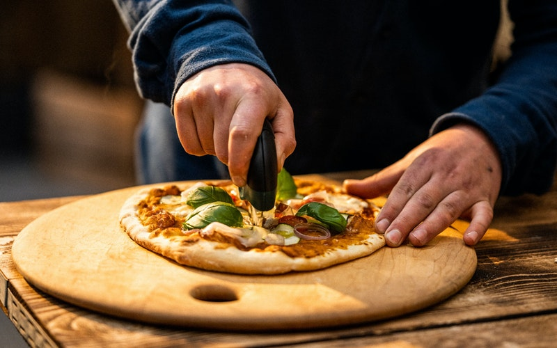 Ultimate Pizza Wheel cutting pizza