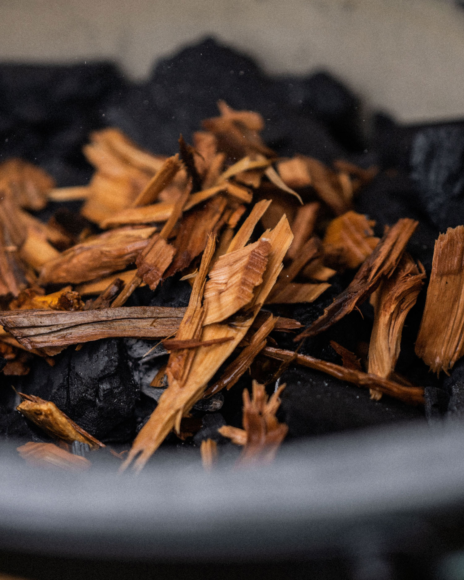 add your pre-soaked smoking chips
