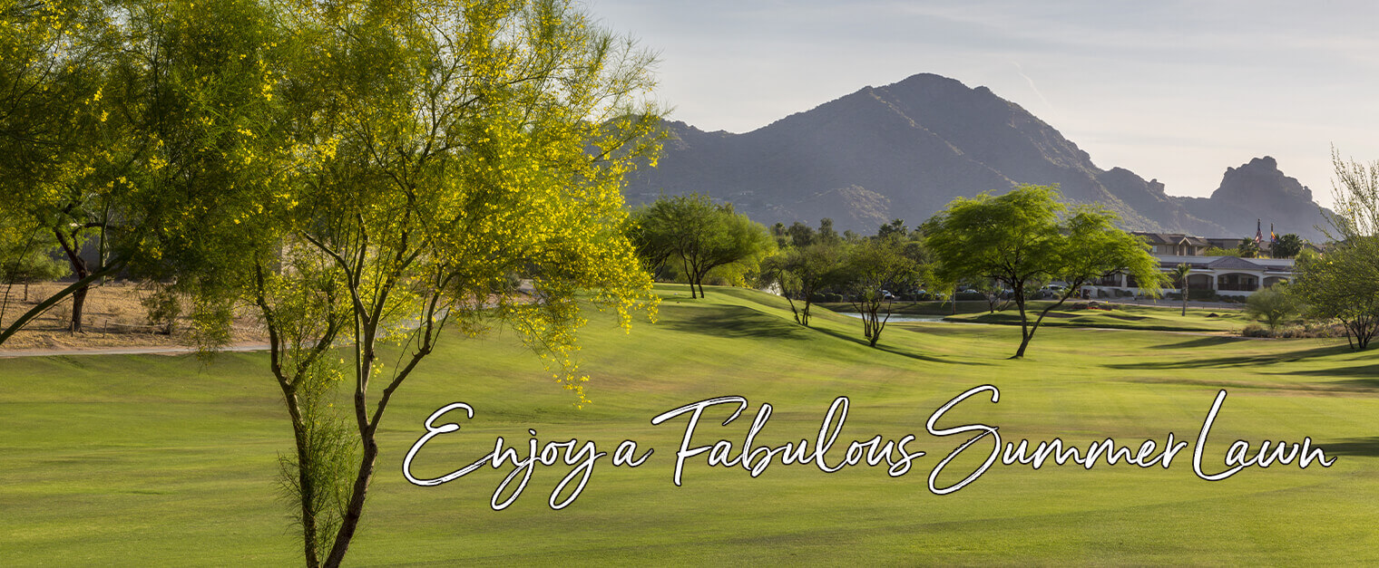 """A great lawn at a golf course with white text on the grass that says """"Enjoy a Fabulous Summer Lawn"""" outlined in black"""