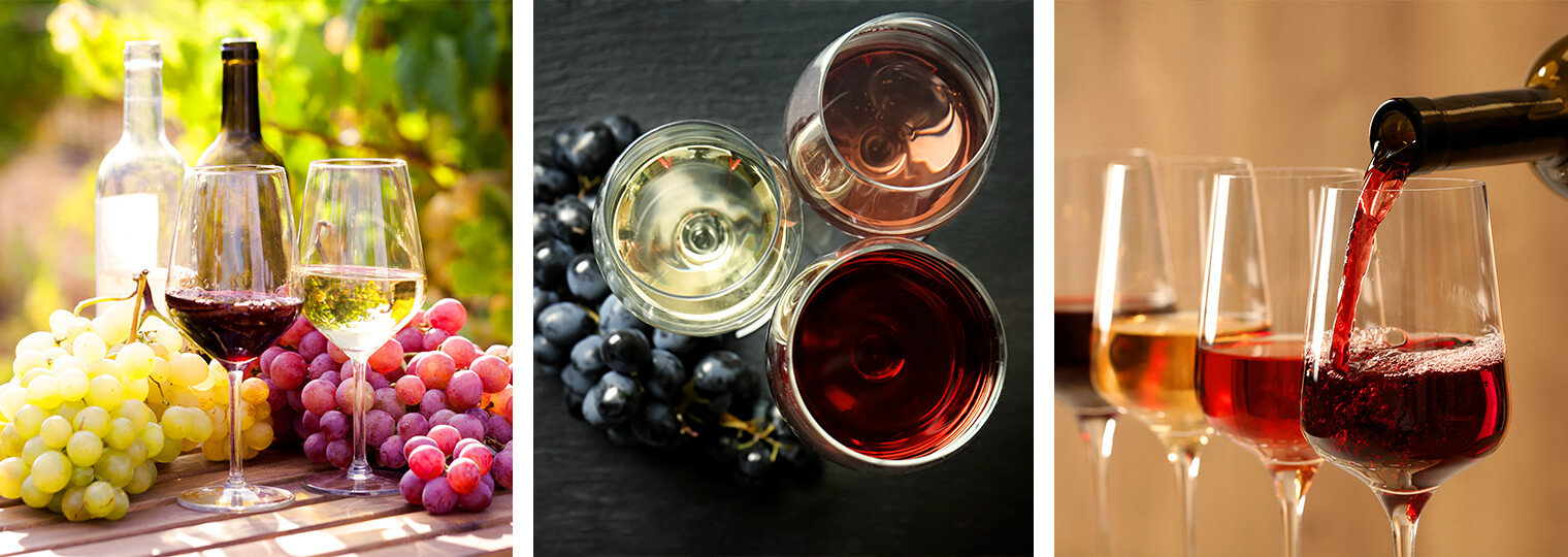 Several glasses of various wines, wine bottles and grapes