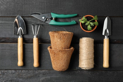 4 Garden Hand Tools, a small potted plant start, string and 2 pulp pots