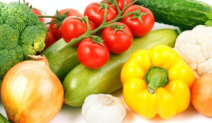 Edible gardening with brocolli, onions, tomatoes, peppers, garlic, cucumbers, and cauliflower