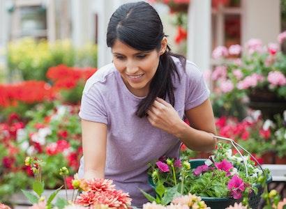 Woman shopping for plants in a garden center