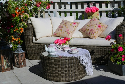 Patio with Seating, Table with Tea Set, Bougainvillea, Geraniums, Roses and Lanterns
